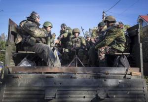Pro-Russian rebels get ready to take position near the Sergey Prokofiev International Airport during fighting with Ukrainian government forces in the town of Donetsk, eastern Ukraine